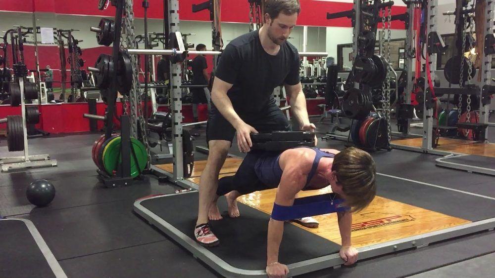 flexión con pesa