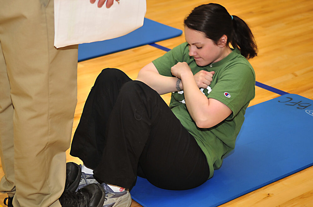 Cómo hacer abdominales sit ups